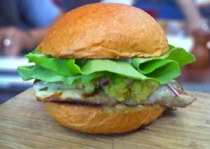 Grilled Mahi sandwich with green mango relish, fresno chili aioli, red onion, butter lettuce on a brioche bun