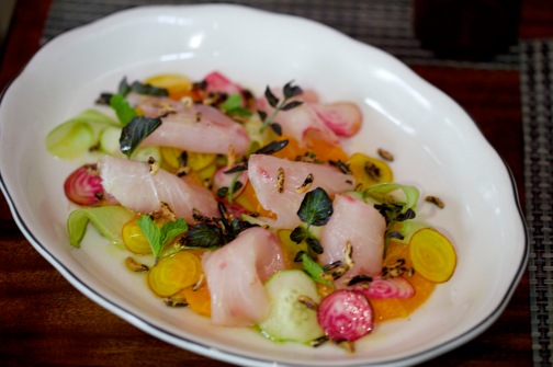 Chef de cuisine Niven Patel's Yellow Jack Crudo with Kumquats and Shaved Vegetables at Michael's Genuine Food & Drink.