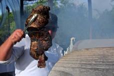 Sous Chef Mike Beltran grilling lamb