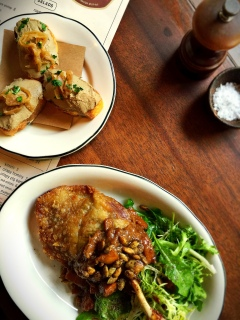 Chicken Liver Crostini and Duck Confit - both appropriate for urban cowpoke to herd.