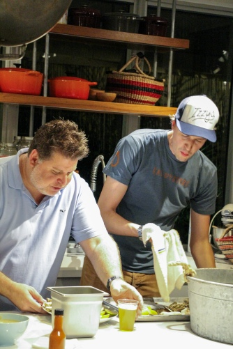 Chefs Jamie DeRosa and William Crandall get to work right away.