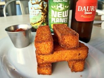 Harry's is our go-to for gluten-free pizza and more. Here, polenta fries and a selection of beer and cider hit the spot.