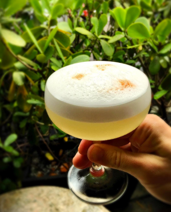 PINEAPPLE PISCO SOUR Pisco Waqar, lime, pineapple, egg white