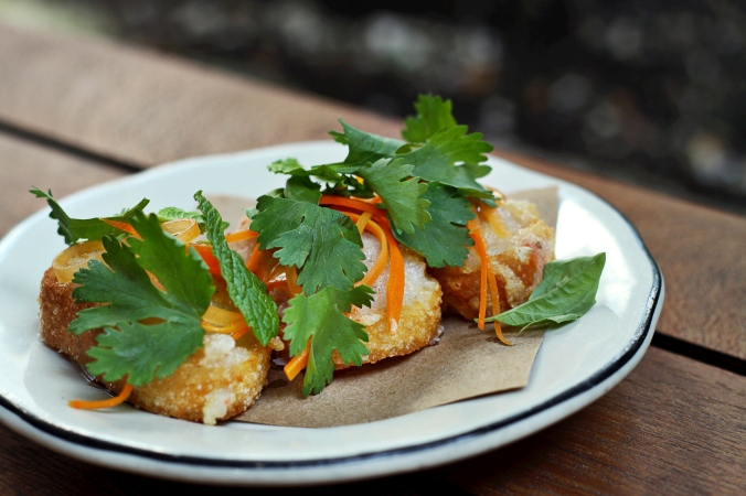 Banh mi packed with shrimp paste and fried into a crispy crostini, with customary julienne pickled carrot and picked herbs.