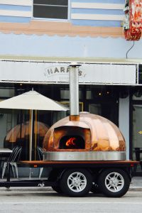 Harry's mobile wood burning oven, the perfect holiday -- or Art Week -- party on wheels.