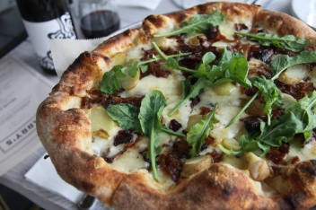 Bacon with caramelized onion, potato, gruyère, arugula