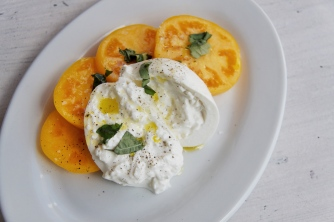 Our new Tomato and Mozzarella Salad... Now Tomato and creamy, silky BURRATA!