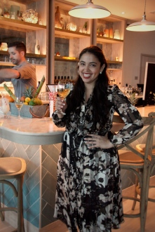Sommelier Amanda Fraga with her rosé, which happens to be ON-TAP (!)