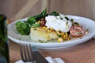 Griddled White Corn Arepas with a poached egg and some other delicious fixins.