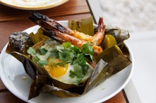 Surf n' Turf, Amara-style: Short Rib Tamal with grilled spicy shrimp and a fried egg