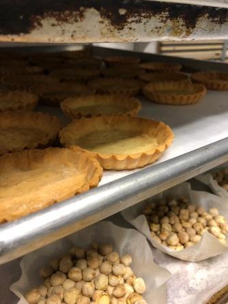 Blind baking tartlette shells.