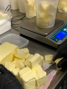Butter measured out for yuca puffs.