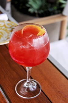 The Tulum Spritz, which has fresno infused tequila, aperol and hibiscus agua fresca. now also with a serving of context.