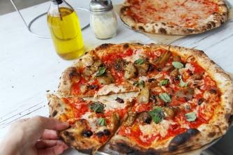 Caponata added to pie with vegan mozz.