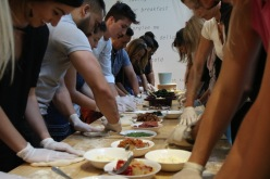 Dillion taking on instructor role at a recent Pizza Making class.